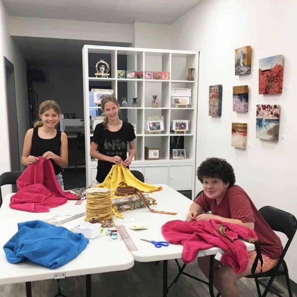 Threadheads students designing beach wraps